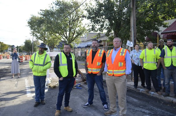 Center, from left to right: Village Department of Public Works Superintendent Matthew Smith, Board member Brian Tymann and Deputy Mayor Ralph Urban. ANISAH ABDULLAH