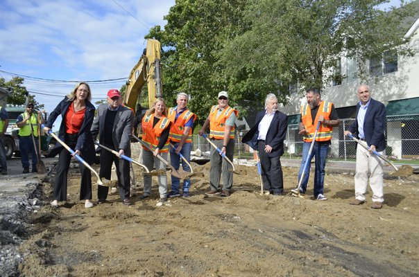 State, town, county and village officials celebrate the start of the Westhampton Beach Main Street reconstruction project Wednesday morning. ANISAH ABDULLAH