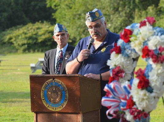 Tony Ganga speaks at the dedication of a 9/11 memorial on the grounds of the American Legion Post in Amagansett on Wednesday.    KYRIL BROMLEY