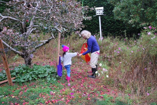 The Retreat Executive Director, Loretta Davis, apple-picking with one of the nonprofits clients.