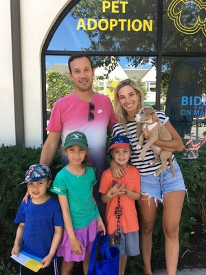 Robert and Blake Brody and their three children adopted Penny Hardaway, originally named Dally, from the Bideawee pop-up adoption center in Westhampton Beach on Labor Day weekend. COURTESY BIDEAWEE
