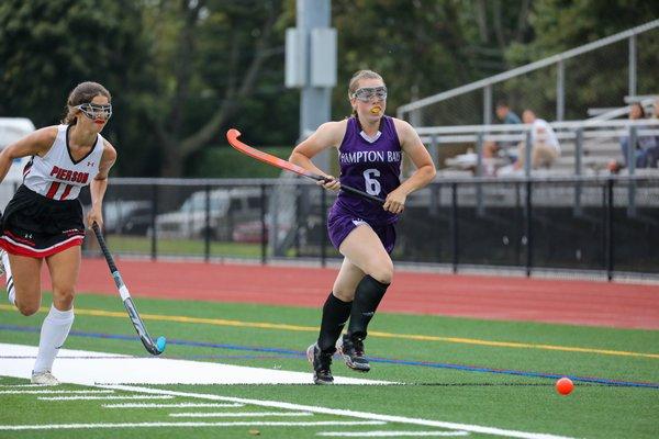 Hampton Bays junior Tara Brochu chases down a loose ball down the sideline.