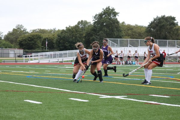 Pierson's Micky Wilson and Hampton Bays sophomore Brianna Diessler both go after the ball.