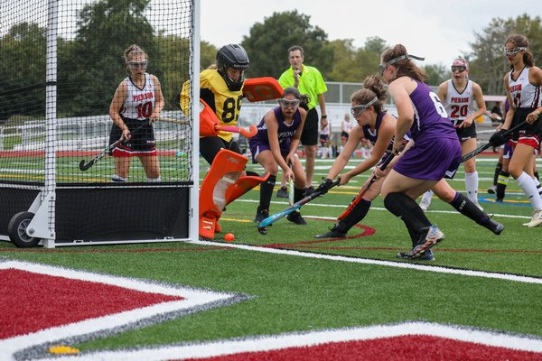 A number of Lady Baymen try to poke the ball in passed Pierson goalie Maeve O'Donoghue but come up empty.