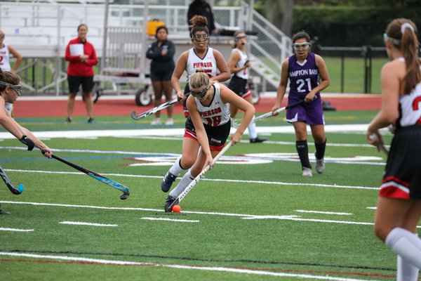 Emma Racelles dribbles the ball at midfield for Pierson.
