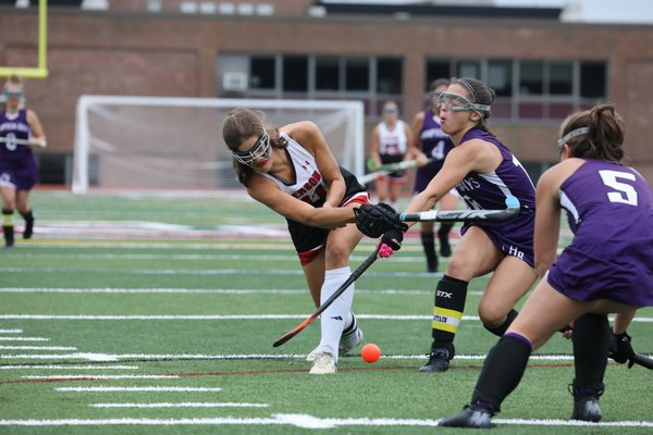 Pierson's Meredith Spolarich attempts a shot on goal with Hampton Bays junior captain Mia Mielenhausen trying to block it.