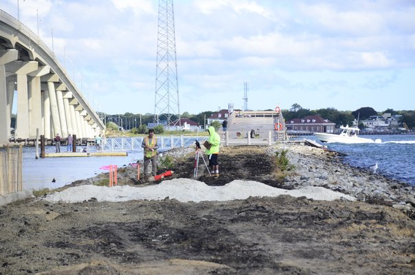 Surveyors were seen working at the Old Ponquogue Bridge pier on Friday morning. GREG WEHNER