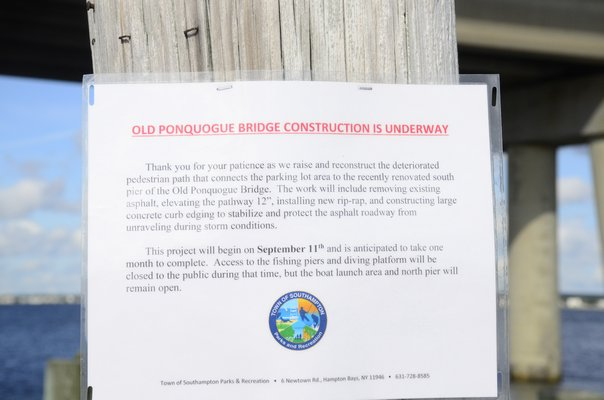 Fishermen were seen fishing on the Old Ponquogue Bridge on Friday, despite a sign noting that the pier was closed for repairs. GREG WEHNER