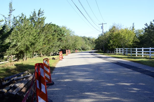 The Suffolk County Water Authority extended the water main down Damascus Road in East Quogue, and the Town of Southampton is paying for homes along the road to connect to the new main. GREG WEHNER