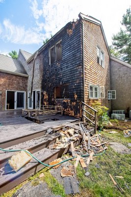 At 12:24 p.m. on Sunday, September 1st, 2019 members of the East Hampton Fire Department were called to extinguish a working deck fire at 225 Old Northwest Road. MICHAEL HELLER/EAST HAMPTON FIRE DEPARTMENT