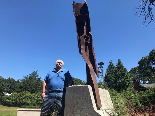 Tony Ganga in front of the memorial on Friday.  ELIZABETH VESPE