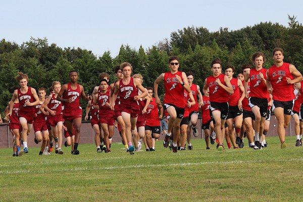 East Hampton and Mount Sinai boys take off at East Hampton High School on September 10.  KYRIL BROMLEY