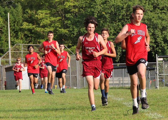East Hampton and Mount Sinai runners make their way to the finish line.