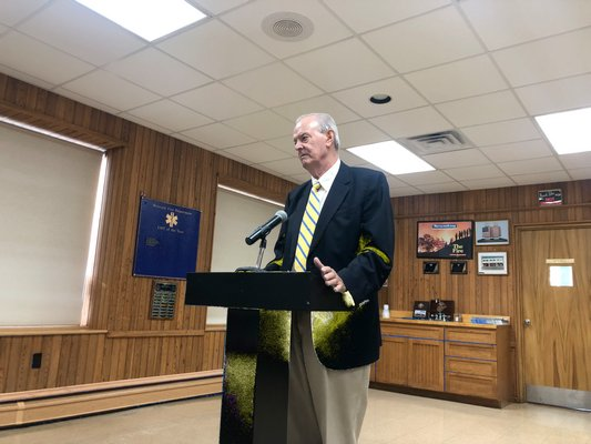 John Keeshan and other Montauk residents implored the Town Board to do away with new lighted crosswalk signs that they say are far too bright and clash with the hamlet's quaint downtown.