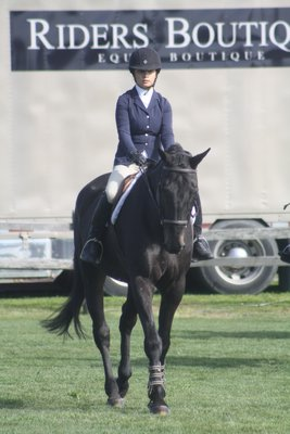 Lauren Reischer and her horse, Reade, in the under-saddle class in the adult equitation division at the Hampton Classic on Sunday, August 25. CAILIN RILEY