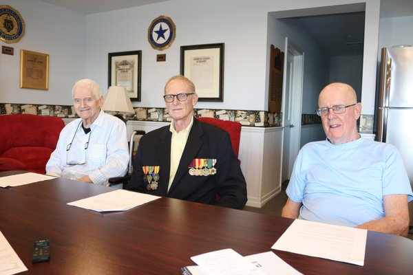 From left, centennial journal writer David Nimz, editor Franky Doty and Robert Browngardt, a Legion member with many family connections in the post's past, were on hand at the Legion Hall recently to talk about the post and the journal project.