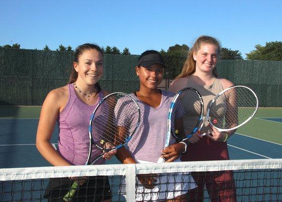 East Hampton's Eva Wojtusiak, left, Juliana Barahona, and Kaylee Mendelman.