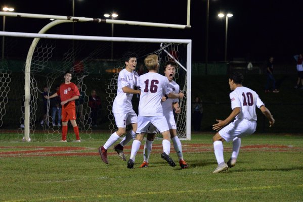 Joey Avallone is pumped up, and so are his teammates, after scoring the Mariners second goal of the game on Friday night, leading to their 2-0 victory at Center Moriches.