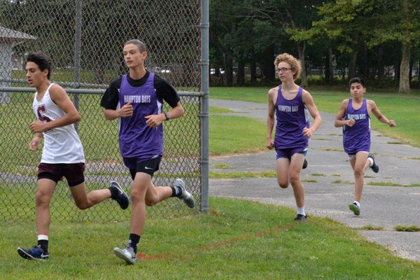 The Baymen head out at the start of the their host Peconic Invitational at Red Creek Park on Thursday, September 5.