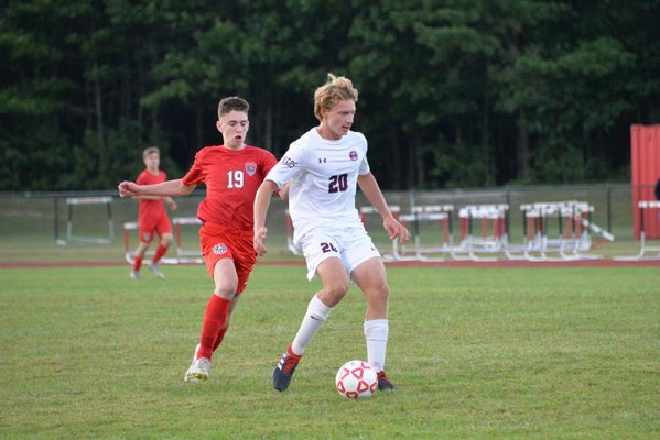 Southampton senior Ben Luss passes the ball before a Center Moriches player bears down on him.