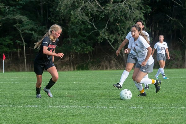 East Hampton junior Kayla Carpio looks to make a move on Pierson junior Brooke Esposito.