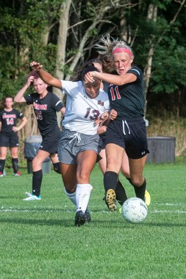 East Hampton eighth-grader Isabella Moreno and Pierson senior Halle Kneeland battle for ball possession.