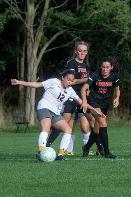 East Hampton junior Kayla Carpio plays the ball.