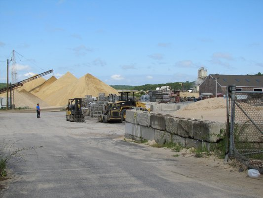 Bothh East Hampton and Southampton towns are working on laws that would allow them to require water testing in and around sand mines within the townships.