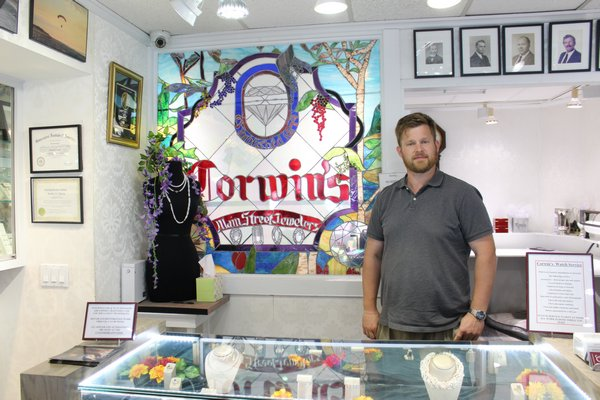 Travis Corwin, fifth generation of owner since 1879, at Corwin's Jewelers on Main Street.  JULIA HALSEY