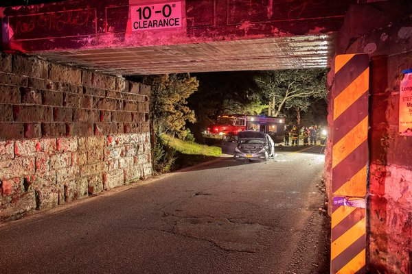 "On the evening of August 27th, members of the East Hampton Fire Department responded with their ""White Knights"" heavy rescue company to Stephen Hands Path in the area of the LIRR trestle for a report of a two-vehicle motor vehicle accident with entrapment. The driver of one vehicle was transported to Southampton Hospital, the other was arrested at the scene for DWI. COURTESY MICHAEL HELLER"