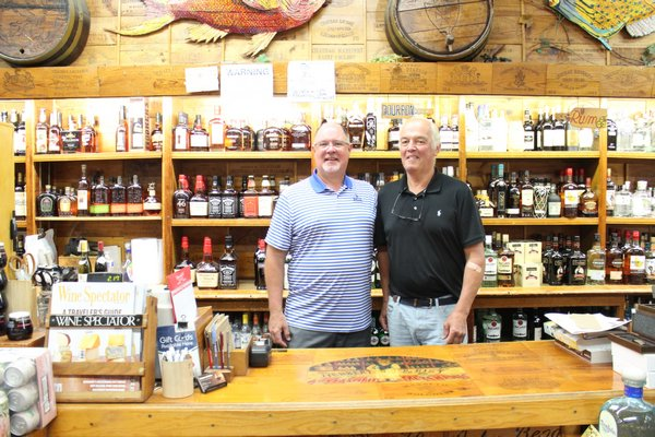 John Noonan and John Rist at Herbert and Rist Wine and Liquor Shop on Jobs Lane.   JULIA HALSEY