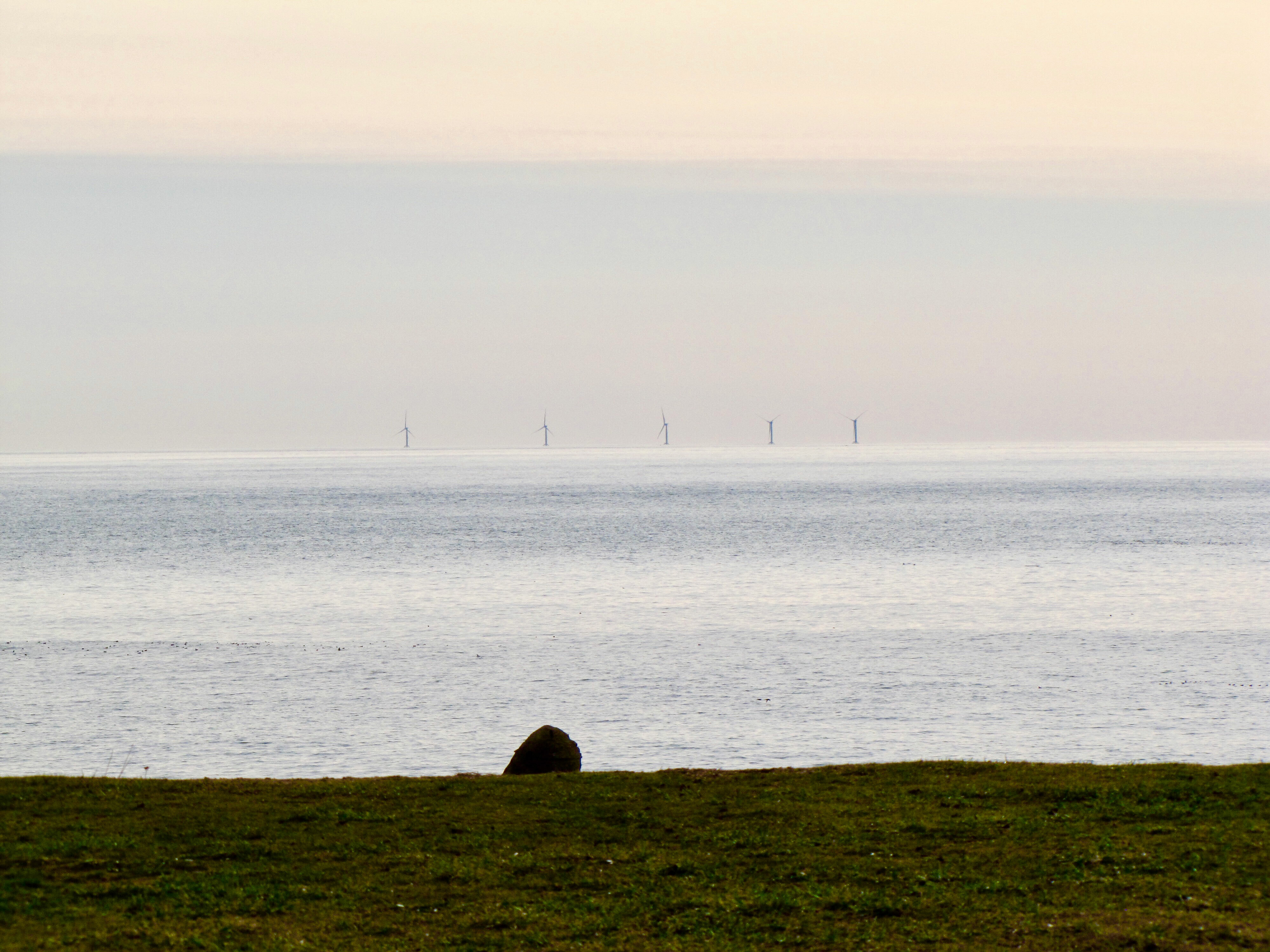 The Block Island Wind Farm as seen from the bluffs in Montauk.