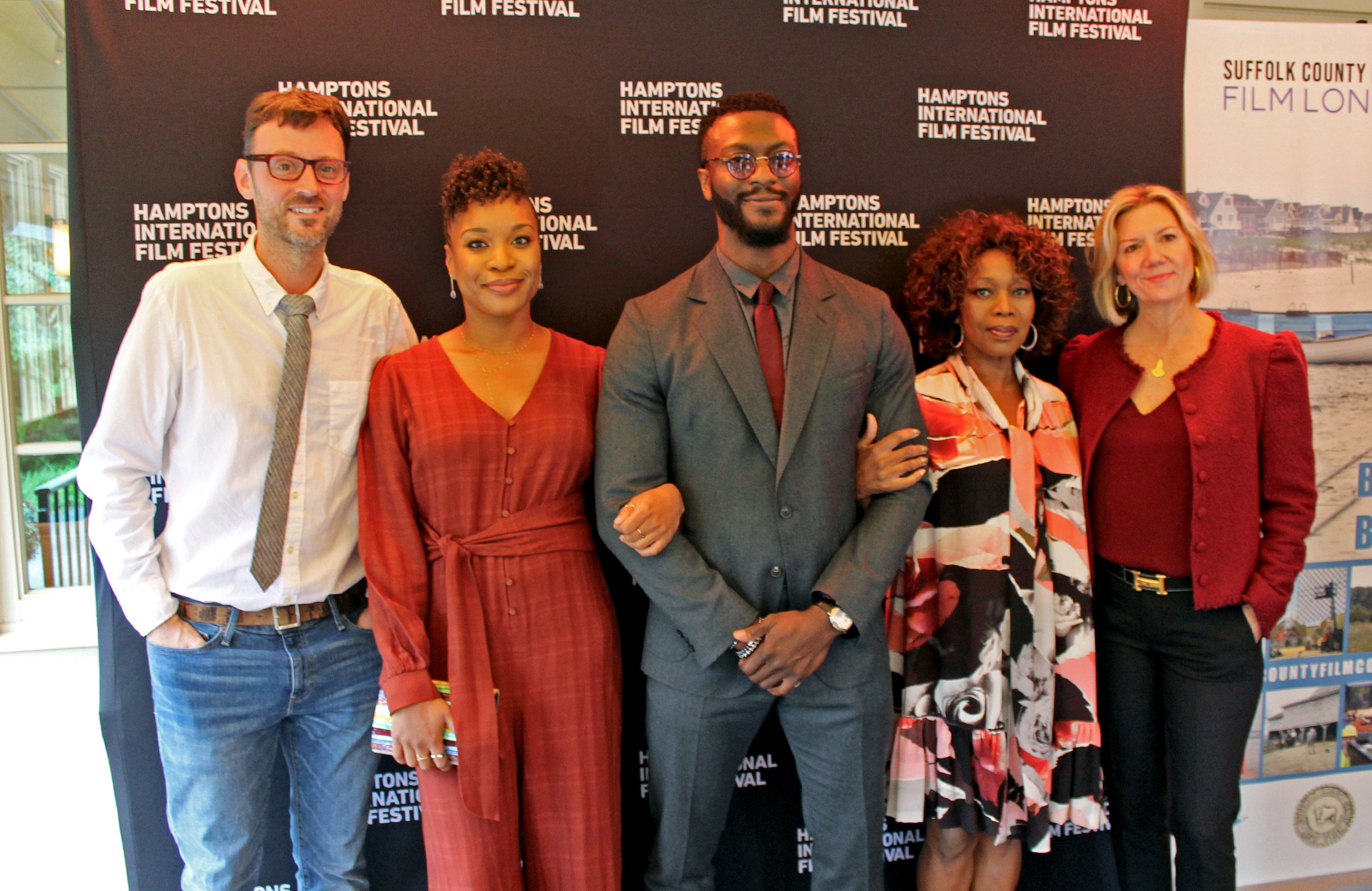 """HIFF artistic director David Nugent, filmmaker Chinonye Chukwu (writer and director of the film """"Clemency""""), actor Aldis Hodge, actress Alfre Woodard, and HIFF executive director Anne Chaisson."""