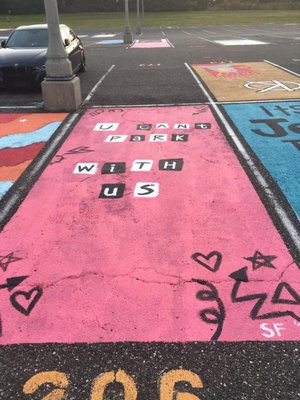 A finished mural in the high school parking lot.