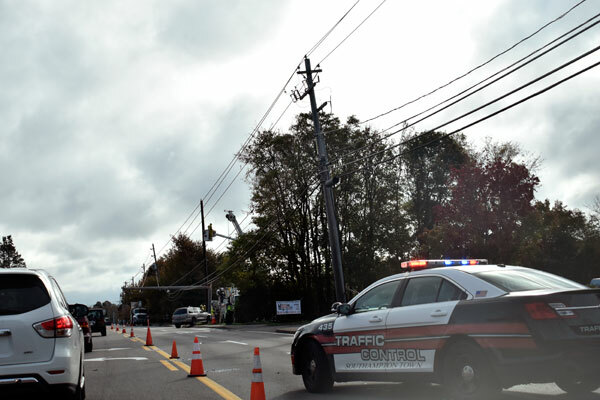 An SUV crashed into a utility pole on County Road 39 on Monday morning. The pole snapped in half and hung over the road. Eastbound lanes were merged into one and shifted to get commuters around the scene as PSEG replaced the pole. BRENDAN J. O'REILLY
