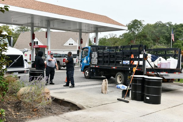 Crews on site cleaning up a fuel spill at the Speedway in Water Mill on Tuesday morning. DANA SHAW