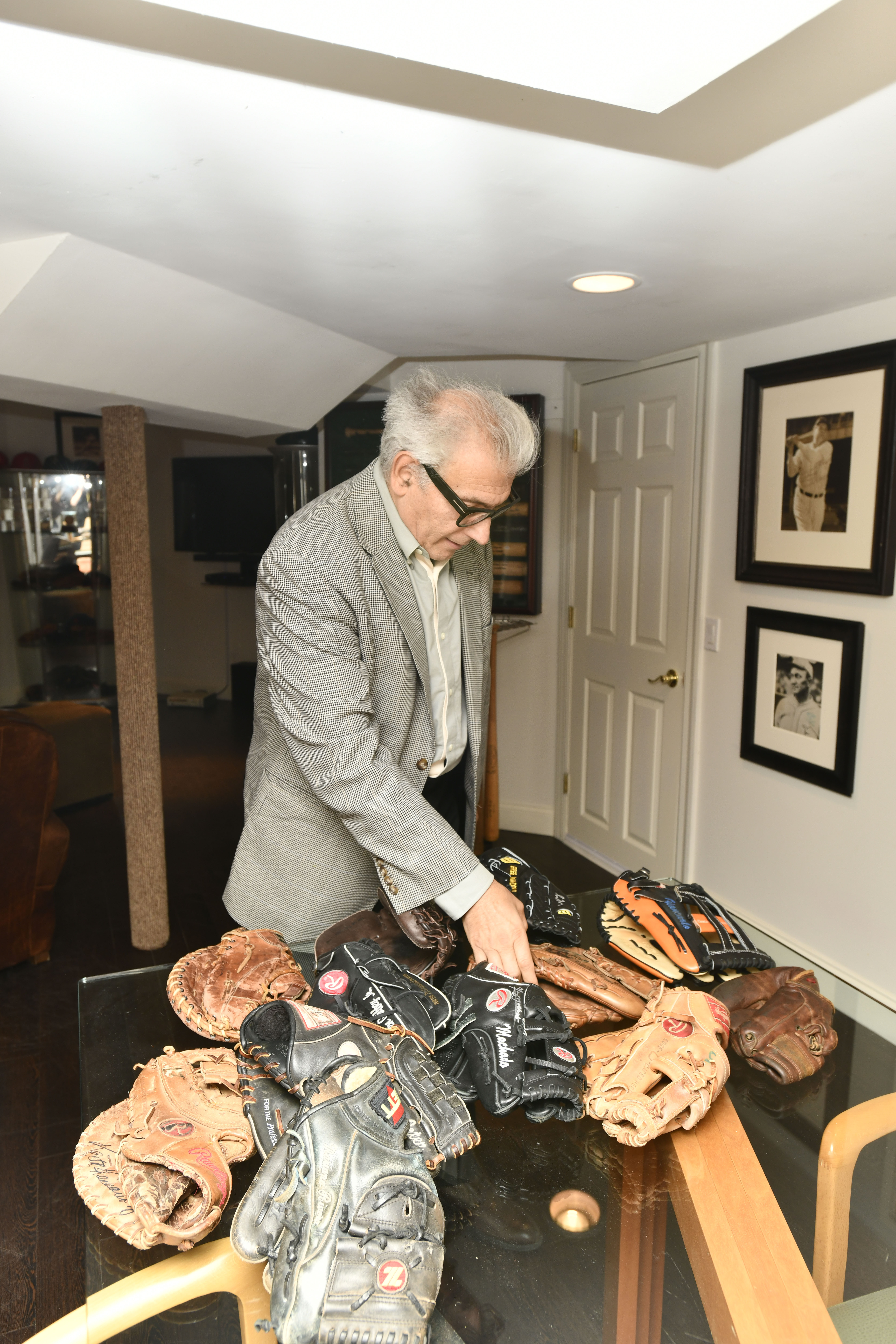 Rick Friedman with some of the baseball gloves from his collection.  DANA SHAW