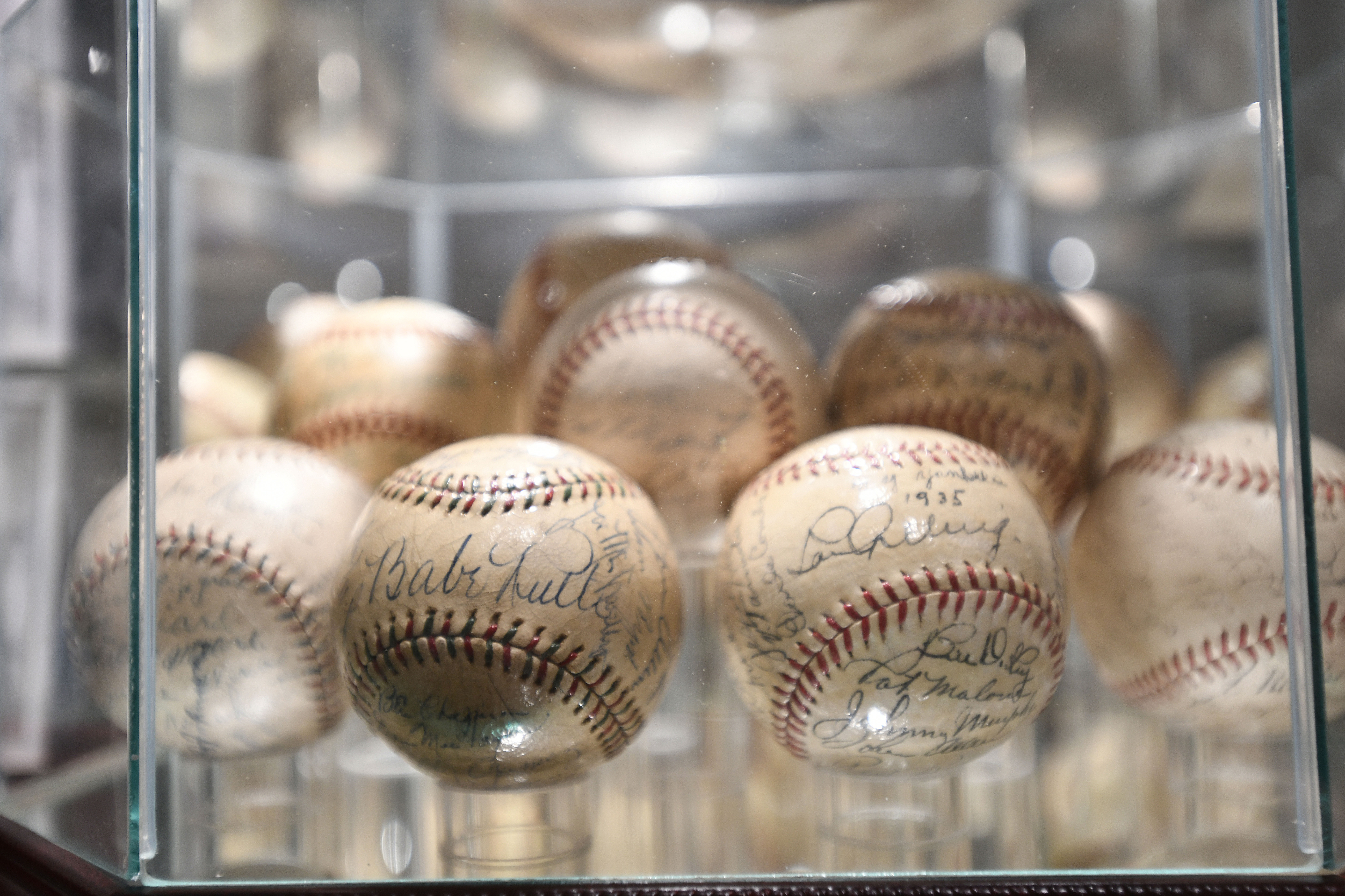 Some of the signed baseballs in Rick Friedman's extensive collection.   DANA SHAW