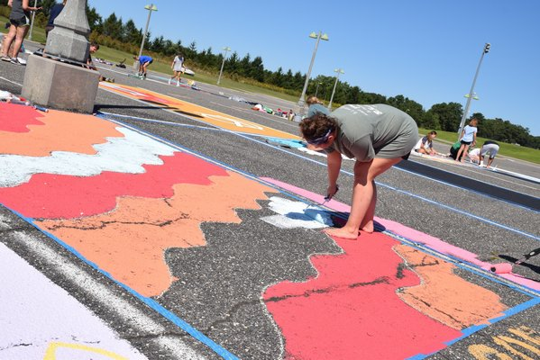 A student in the midst of completing her parking spot.