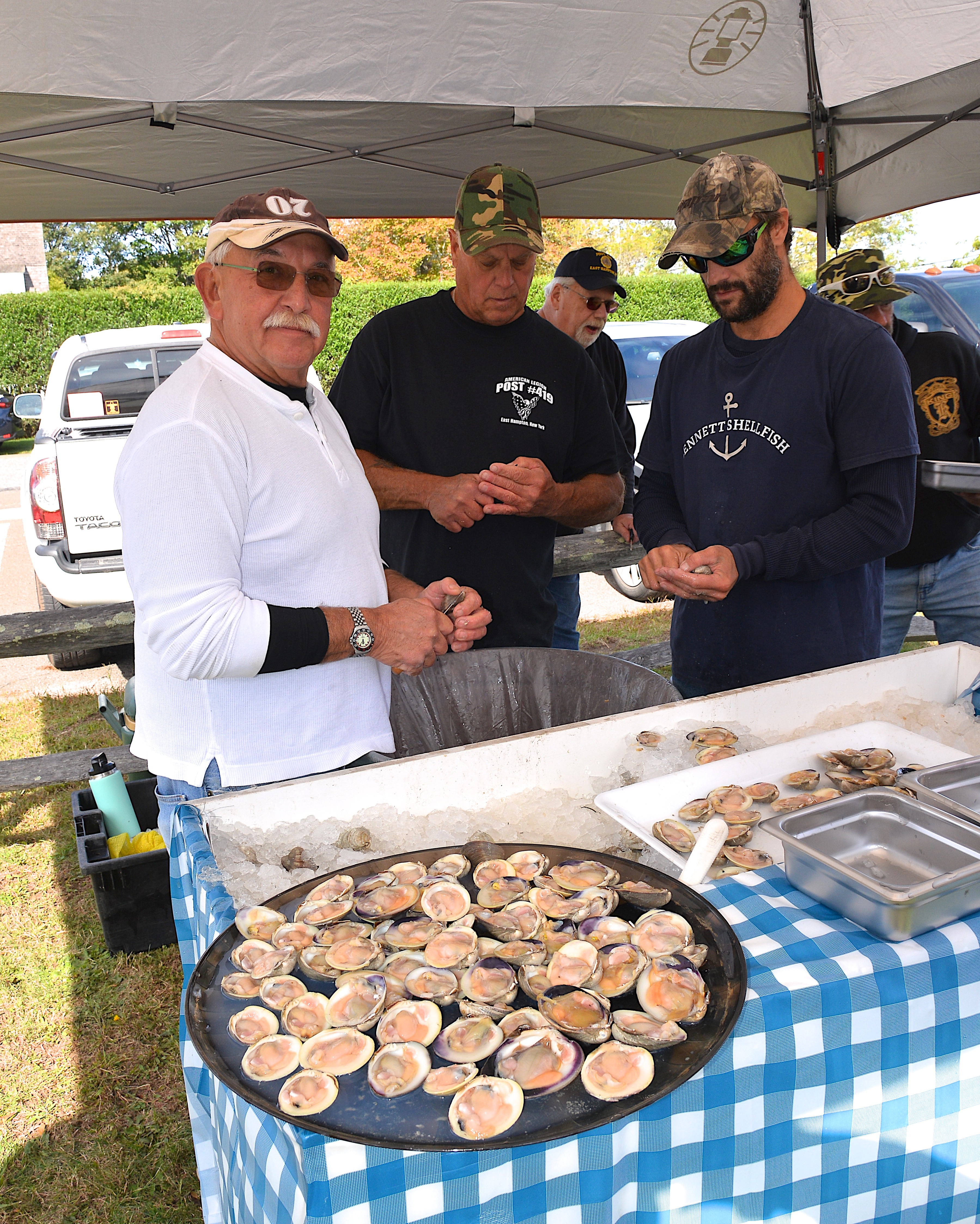 Paul Roman shucking clams at the Trustee's contest on Sunday.   KYRIL BROMLEY