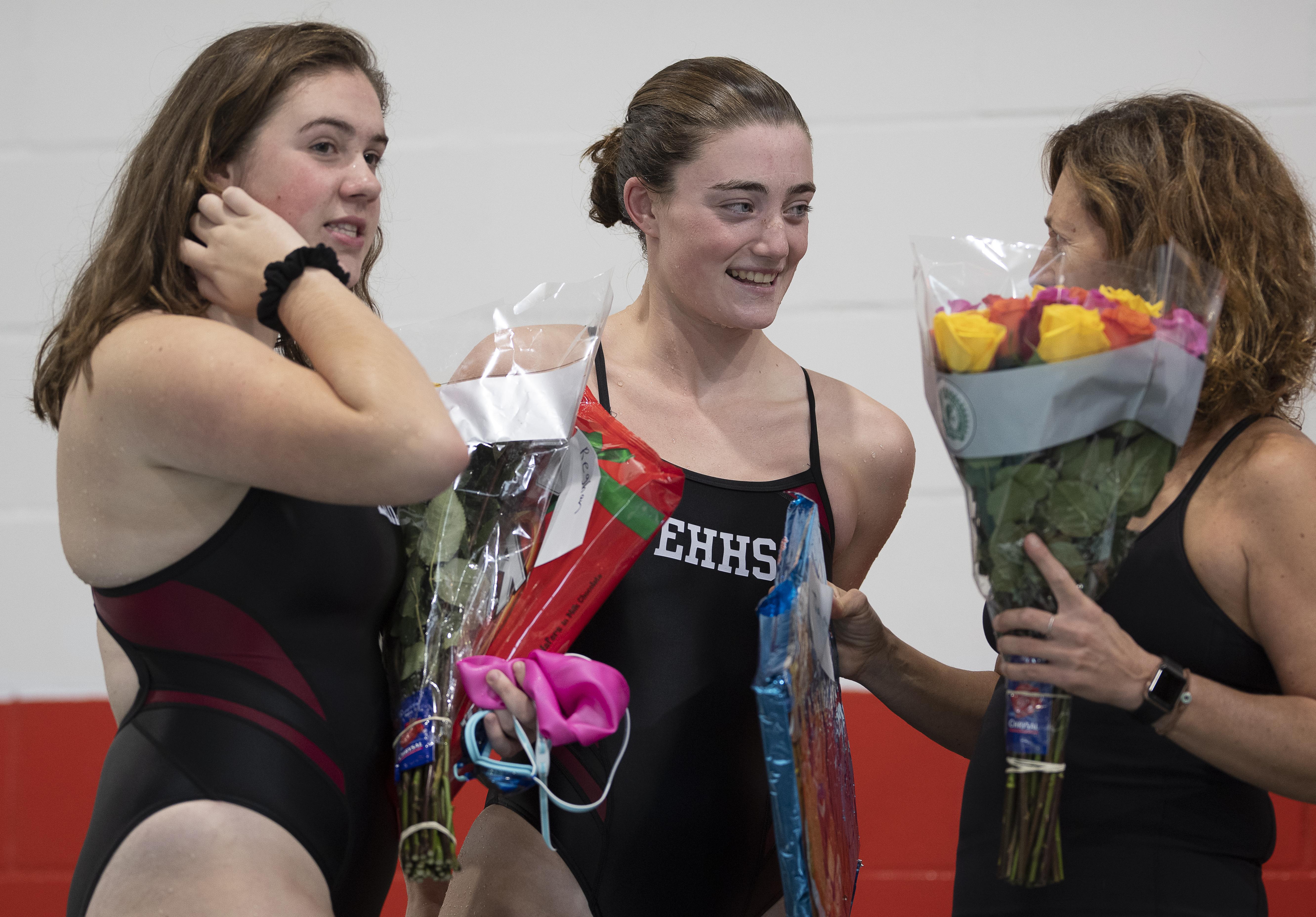East Hampton seniors Reghan Anderson and Tiana Treadwell greet family and friends after swimming their