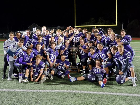The Baymen celebrate their 29-0 victory over Southampton with the Mayor's Cup on Friday night.