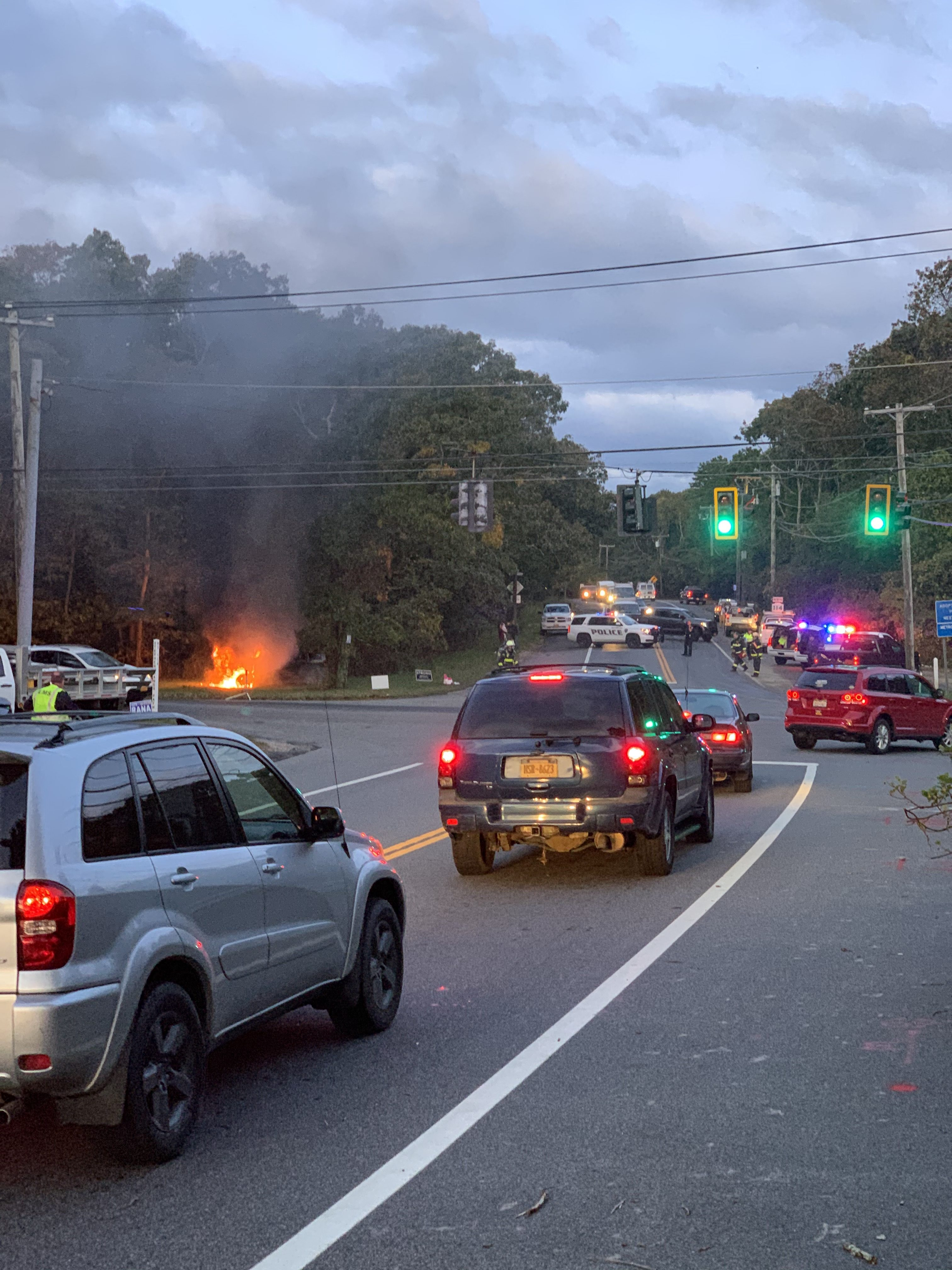 A car fire on the corner of Stephen Hand's Path and Route 114 in East Hampton Thursday morning. COURTESY CHRIS BUCKHOUT
