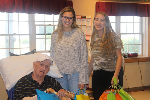 David Walker happily accepts his gift bag from Allyson and Siobhan.