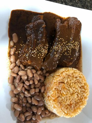 Mole Poblano with rice and beans.