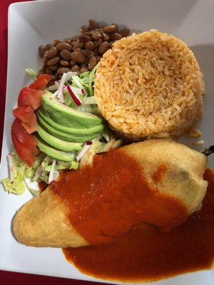 Chile Relleno with rice, beans, and avocado.