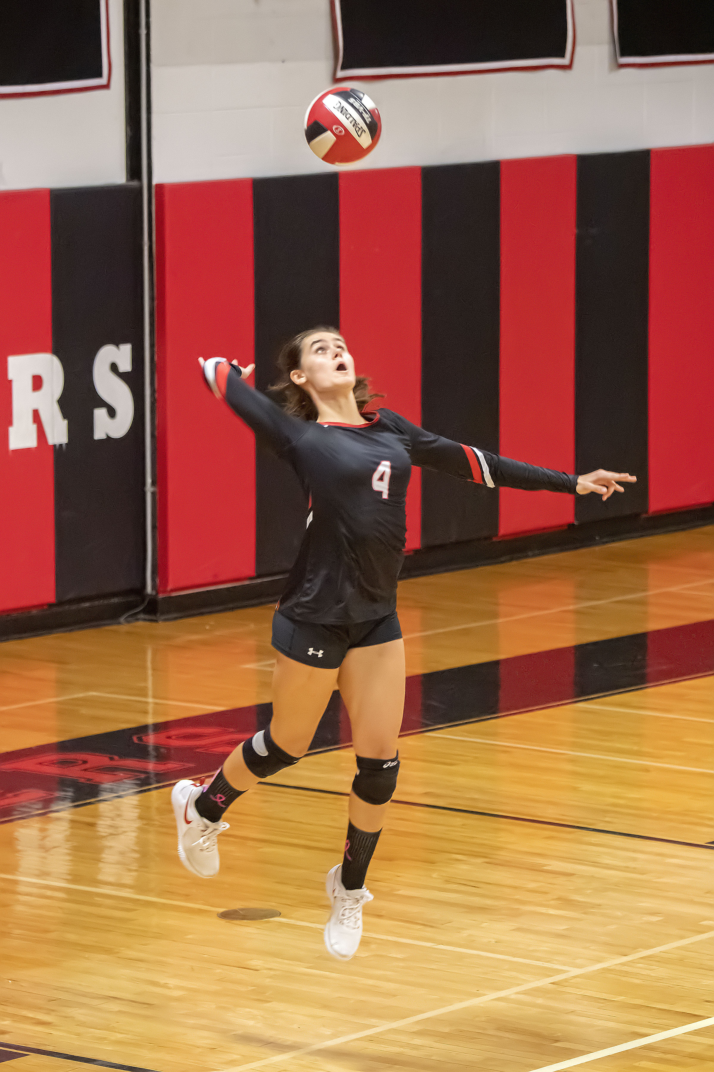 Pierson's Samantha Cox goes up for a serve.