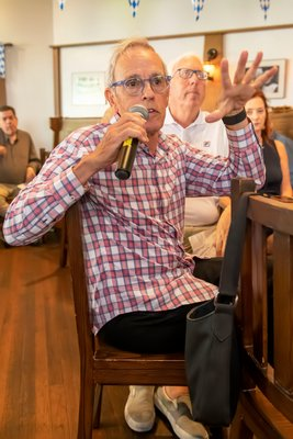 An attendee asks a question during the Press Sessions: Wind Farm forum at Rowdy Hall in East Hampton.    MICHAEL HELLER