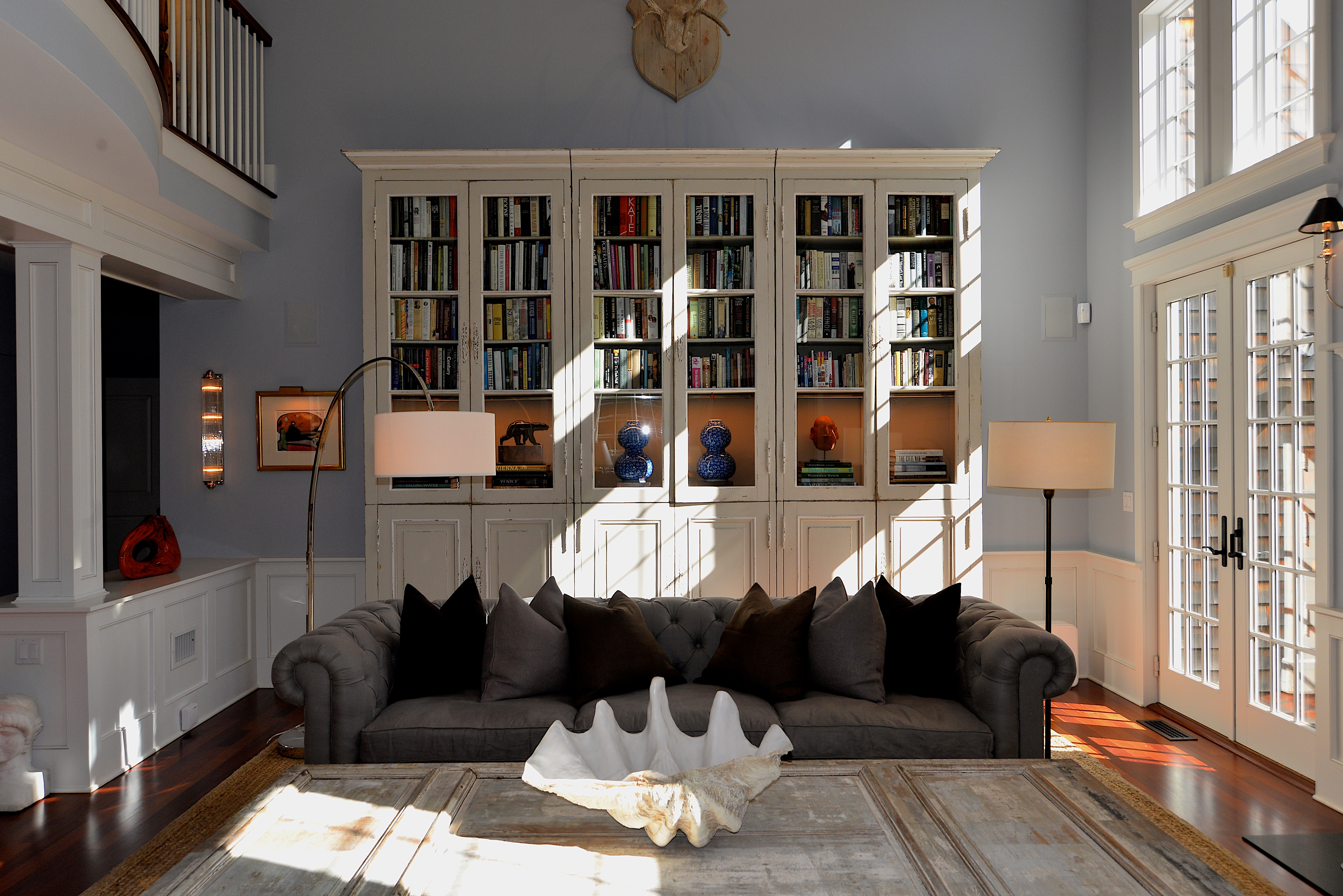 A nearly 12-foot-tall French country bookcase built in three sections and modified with lighting elements.