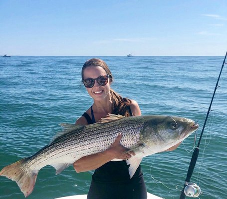 Megan Conger, of the DockTauk fishing podcast, got this nice striped bass while fishing aboard the charter boat Push The Limit with Capt. Ben McCarron.